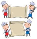 两个有横幅纸卷的滑稽的孩子厨师 库存照片