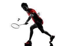 Силуэт молодого человека игрока бадминтона Стоковое фото RF