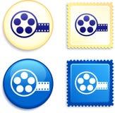 Εξέλικτρο ταινιών στο γραμματόσημο και το κουμπί Στοκ Φωτογραφία
