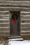 圣诞节原木小屋 免版税库存照片