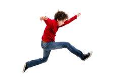 年轻男孩跳跃 图库摄影
