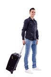 带着手提箱的年轻旅客 免版税库存图片