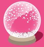 与里面小白色心脏的不可思议的水晶球 库存照片