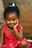 面孔被射击逗人喜爱的非洲女孩。 免版税库存图片