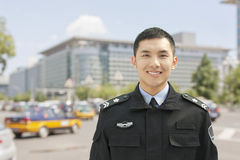 微笑的警察,画象,中国 库存图片