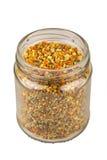 瓶子新鲜的蜂花粉 免版税库存照片
