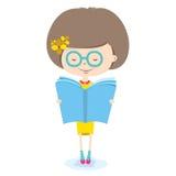 女孩阅读书。 图库摄影
