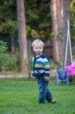 逗人喜爱的婴孩在公园 库存照片