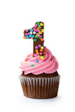 第一块生日杯形蛋糕 库存图片