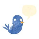 减速火箭的与讲话泡影的动画片蓝色鸟 免版税库存照片