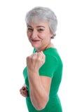 在白色隔绝的强有力和健康灰发的妇女。 免版税图库摄影