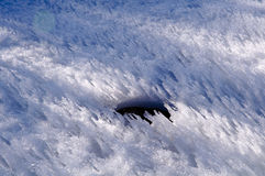 在冰的孔 图库摄影