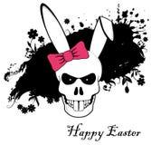 有红色弓的滑稽的复活节兔子头骨 免版税图库摄影