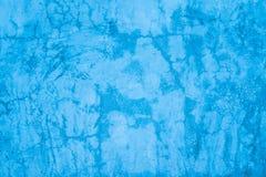 被设计的蓝色难看的东西涂了灰泥墙壁纹理,背景 免版税库存图片