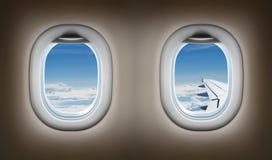 两个飞机窗口。喷气机内部。 库存图片
