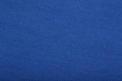 Голубая предпосылка текстуры ткани Стоковые Фото