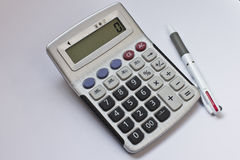 笔和计算器 免版税库存图片