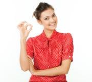 完善-显示好手标志的女商人。 免版税库存图片