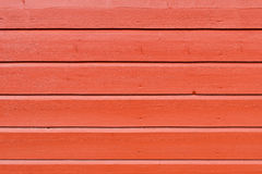 被绘的红色板条木墙壁背景 库存图片