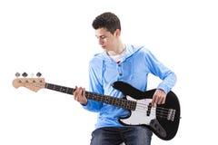 有一把电吉他的少年 库存照片