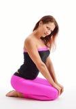 体育的一名亭亭玉立的妇女为健身穿衣 库存图片