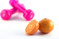 哑铃集中橙色粉红色 图库摄影