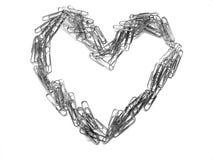 Сердце бумажного зажима символизируя влюбленность дела Стоковые Изображения