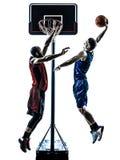 蓝球运动员人跳跃的泡的剪影 免版税库存图片