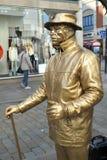 Золотой уличный исполнитель человека Стоковая Фотография RF