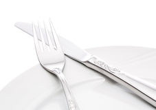 Πιάτο με το δίκρανο και το μαχαίρι Στοκ φωτογραφίες με δικαίωμα ελεύθερης χρήσης