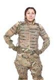 有步枪的美丽的军队女孩 免版税图库摄影