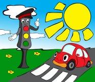 有红色汽车的红绿灯 库存图片