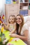 母亲和她的婴孩在复活节期间 免版税库存照片
