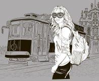 时尚女孩和老电车 库存照片