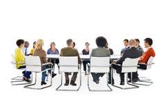 小组不同种族的人在会议 免版税图库摄影