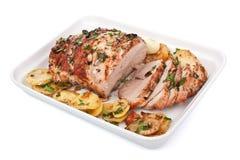 烤猪肉腰部用土豆 免版税库存照片