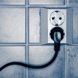 Заткнутый шнур питания Стоковая Фотография