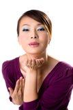 亚洲吹的女孩亲吻 免版税库存照片