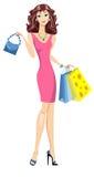 有袋子的时尚女孩。 免版税库存照片