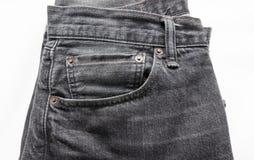 被折叠的蓝色牛仔裤 免版税库存图片