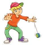 演奏溜溜球的小男孩 库存照片