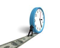 在金钱途中的辗压时钟 免版税库存照片