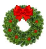 Στεφάνι Χριστουγέννων με το μούρο ελαιόπρινου και το κόκκινο τόξο κορδελλών Στοκ εικόνα με δικαίωμα ελεύθερης χρήσης