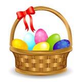 与弓的复活节彩蛋篮子 免版税库存图片