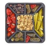 在白色的开胃小菜盛肉盘 库存照片