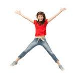 跳跃的十几岁的女孩 免版税库存照片