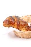 新月形面包的图象与鸦片的在篮子 库存照片