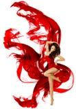 在红色礼服的妇女跳舞,时装模特儿舞蹈 免版税库存图片