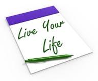 居住您的生活笔记本展示享受或 免版税库存照片