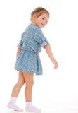 获得迷人的小女孩演奏和乐趣。 库存照片